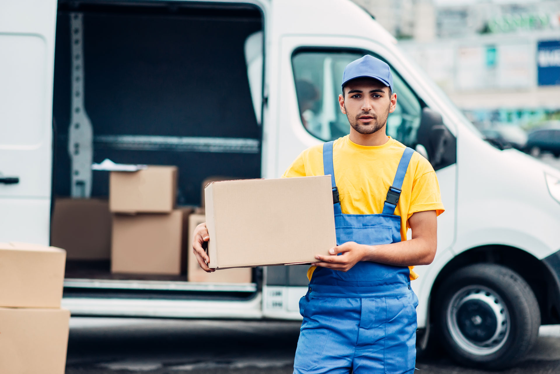 cargo-delivery-service-male-courier-unload-truck-P2CJTLY.jpg